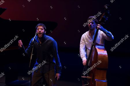 Portuguese singer Salvador Sobral (L) performs during a concert at the Museo Universidad de Navarra in Pamplona, Spain, 27 September 2018, to present his new album, 'Excuse me'.