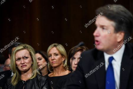Laura Cox Kaplan, left, tears up while seated behind Judge Brett M. Kavanaugh, at a Senate Judiciary Committee hearing