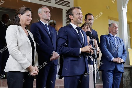 French President Emmanuel Macron (C) delivers a speech flanked French Minister for Solidarity and Health Agnes Buzyn (L), President of the French National Assembly Francois de Rugy (2-L), French Overseas Minister Annick Girardin (3-R), French Junior Minister attached to the Minister of Ecological and Inclusive Transition Sebastien Lecornu (2-R) and French Minister for the Territorial Cohesion Jacques Mezard (R) at the prefecture of Fort-de-France, Martinique, France, 27 September 2018. French President Macron is on a four-day visit to the French Antilles.