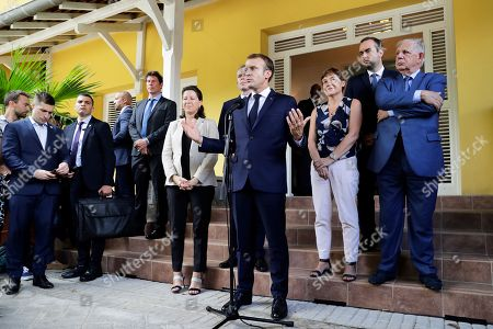 French President Emmanuel Macron (C) delivers a speech flanked by French Minister for Solidarity and Health Agnes Buzyn (6-L), French Overseas Minister Annick Girardin (3-R), French Junior Minister attached to the Minister of Ecological and Inclusive Transition Sebastien Lecornu (2-R) and French Minister for the Territorial Cohesion Jacques Mezard (R) at the prefecture of Fort-de-France, Martinique, France, 27 September 2018. French President Macron is on a four-day visit to the French Antilles.