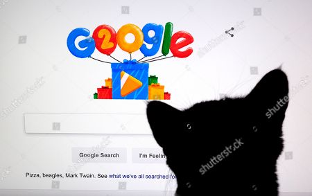 Stock Photo of Google Doodles celebrates the search engine's 20th Anniversary as seen on the home page in Mountain View, California, USA, 27 September 2018. Google was founded by two Stanford University students, Larry Page and Sergey Brin in 1998.