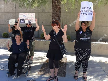 Stock Picture of Lisa McAllister, left, Virginia Wisdom, center, and Karina Provost demonstrate in support of Christine Blasey Ford in Las Vegas on . Nevada's Republican governor says the U.S. Senate should not cast a final vote on the U.S. Supreme Court nomination of Brett Kavanaugh without a full review of the allegations of sexual misconduct that have been made against the nominee