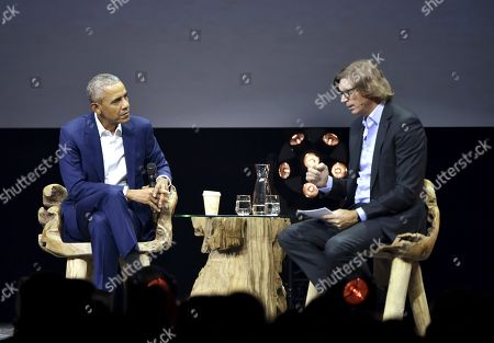 Former President of the United States, Barack Obama (L) discusses with Swedish entrepreneur Niklas Zennstrom (R), founder of Kazaa, Skype and Atomico during the Nordic Business Forum seminar in Helsinki.