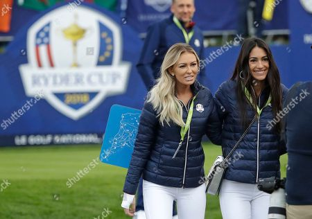Paulina Gretzky, the partner of Dustin Johnson of the US, left, and Allison Stokke, the girlfriend of Rickie Fowler of the US pose for a photo as they arrive to watch their partners fourball match on the opening day of the 42nd Ryder Cup at Le Golf National in Saint-Quentin-en-Yvelines, outside Paris, France