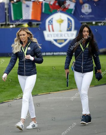 Paulina Gretzky, the partner of Dustin Johnson of the US, left, and Allison Stokke, the girlfriend of Rickie Fowler of the US arrive to watch their partners fourball match on the opening day of the 42nd Ryder Cup at Le Golf National in Saint-Quentin-en-Yvelines, outside Paris, France