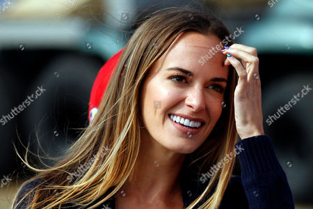 Jena Sims the partner of Brooks Koepka of the US rides a golf cart after Koepka and his teammate Tony Finau won their fourball match against Europe players Justin Rose and Jon Rahm on the opening day of the 42nd Ryder Cup at Le Golf National in Saint-Quentin-en-Yvelines, outside Paris, France