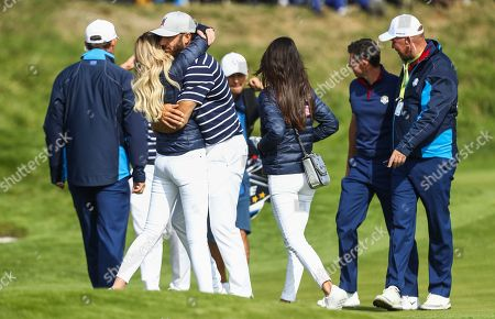 Dustin Johnson of USA gets a kiss from Partner Paulina Gretzky after he won his match on the 16th hole