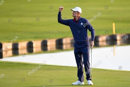 Justin Rose of England reacts after making a birdy by the 1st hole during the Ryder Cup 2018 at The Golf National in Guyancourt, near Paris, France, 28 September 2018. The Ryder Cup 2018 runs from 25 to 30 September.