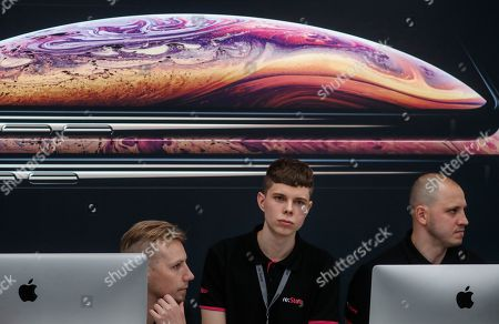 Re-Store sales people wait for customers during start of the sale of new Apple products, the new iPhone XS and iPhone XS Max, in the Apple Store in Moscow, Russia, 28 September 2018. Apple introduced the new iPhone models on 12 September 2018. Media reports state that the popularity of new iPhone models in Russia has fallen compared to the iPhone X released in 2017.