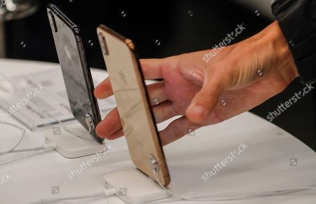 A customer tests the new iPhone XS Max in the Apple Store in Moscow, Russia, 28 September 2018. Apple introduced the new iPhone models on 12 September 2018. Media reports state that the popularity of new iPhone models in Russia has fallen compared to the iPhone X released in 2017.