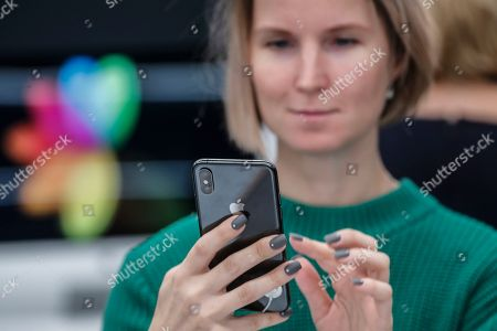 A customer tests the new iPhone XS  in the Apple Store in Moscow, Russia, 28 September 2018. Apple introduced the new iPhone models on 12 September 2018. Media reports state that the popularity of new iPhone models in Russia has fallen compared to the iPhone X released in 2017.