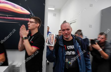 A customer buys the new iPhone XS Max in the Apple Store in Moscow, Russia, 28 September 2018. Apple introduced the new iPhone models on 12 September 2018. Media reports state that the popularity of new iPhone models in Russia has fallen compared to the iPhone X released in 2017.