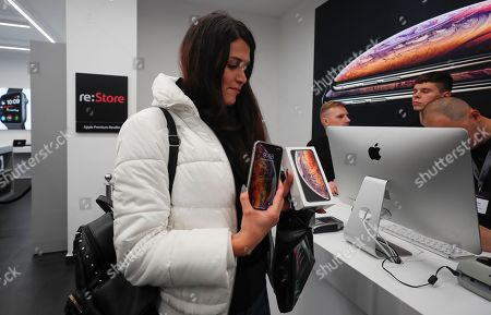 Stock Photo of A customer buys the new iPhone XS Max in the Apple Store in Moscow, Russia, 28 September 2018. Apple introduced the new iPhone models on 12 September 2018. Media reports state that the popularity of new iPhone models in Russia has fallen compared to the iPhone X released in 2017.