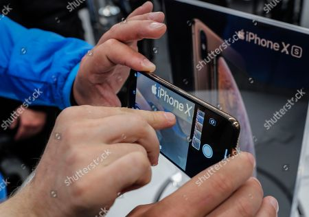 Customers test the new iPhone XS Max in the Apple Store in Moscow, Russia, 28 September 2018. Apple introduced the new iPhone models on 12 September 2018. Media reports state that the popularity of new iPhone models in Russia has fallen compared to the iPhone X released in 2017.