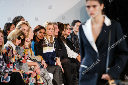 Stock Picture of Director and executive Vice President of Louis Vuitton Delphine Arnault (C) attends the presentation of the Spring/Summer 2019 Women's collection by Spanish fashion house Loewe during the Paris Fashion Week, in Paris, France, 28 September 2018. The presentation of the Women's collections runs from 24 September to 02 October.