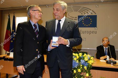 European Parliament President, Antonio Tajani (R) presents the European Citizen Award to the founder of the Cerci Amarante, Antonio Pinto Monteiro (L), during a ceremony held at the European Paliament Cabinet in Lisbon, Portugal, 28 September 2018.