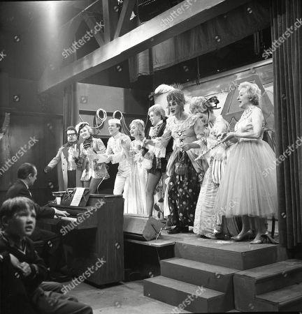 The Coronation Street pantomime. Eddie King (as Alf Chadwick), Jack Howarth (as Albert Tatlock), Eileen Derbyshire (as Emily Nugent), Philip Lowrie (as Dennis Tanner), Jennifer Moss (as Lucille Hewitt), Pat Phoenix (as Elsie Tanner), Gordon Rollings (as Charlie Moffitt), Sandra Gough (as Irma Ogden) and Doris Speed (as Annie Walker)