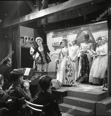 The Coronation Street pantomime. Eddie King (as Alf Chadwick), Pat Phoenix (as Elsie Tanner), Eileen Derbyshire (as Emily Nugent), Jennifer Moss (as Lucille Hewitt), Philip Lowrie (as Dennis Tanner), Gordon Rollings (as Charlie Moffitt), Sandra Gough (as Irma Ogden) and Doris Speed (as Annie Walker)