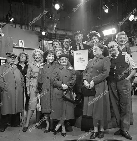Coronation Street cast members celebrate winning the best British series award from The Viewer magazine. Jack Howarth (as Albert Tatlock), Anne Reid (as Valerie Barlow), Betty Alberge (as Florrie Lindley), Eileen Derbyshire (as Emily Nugent), Peter Adamson (as Len Fairclough), Doreen Keogh (as Concepta Hewitt), Lynne Carol (as Martha Longhurst), Ivan Beavis (as Harry Hewitt), Philip Lowrie (as Dennis Tanner), Pat Phoenix (as Elsie Tanner), Violet Carson (as Ens Sharples), Arthur Leslie (as Jack Walker) and Doris Speed (as Annie Walker|)