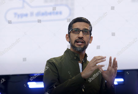 Google CEO Sundar Pichai speaks at the Google I/O conference in Mountain View, Calif. Pichai is scheduled to meet privately with members of Congress Friday, Sept. 28, after he and his boss, Google co-founder Larry Page, stood up lawmakers at a public hearing earlier this month. The closed-door gathering is expected to include discussions about President Donald Trump's recent allegations that Google has been rigging the results of its influential search engine to suppress conservative viewpoints. Google has denied any political bias