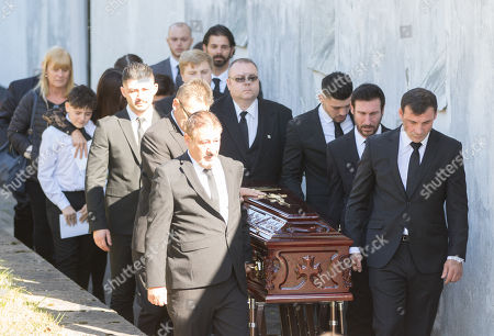 Stock Picture of Former World Champion boxer Joe Calzaghe, right, leads the coffin out of the church at the funeral of his father and boxing trainer Enzo Calzaghe