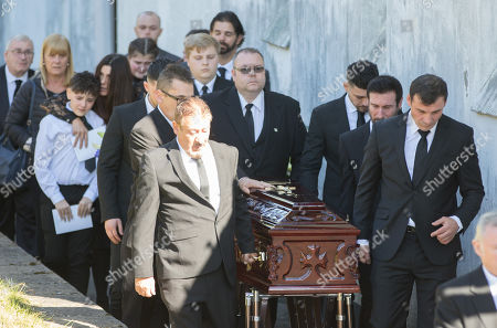 Former World Champion boxer Joe Calzaghe, right, leads the coffin out of the church at the funeral of his father and boxing trainer Enzo Calzaghe
