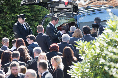 Stock Photo of Former World Champion boxer Joe Calzaghe after he lead the coffin out of the church at the funeral of his father and boxing trainer Enzo Calzaghe