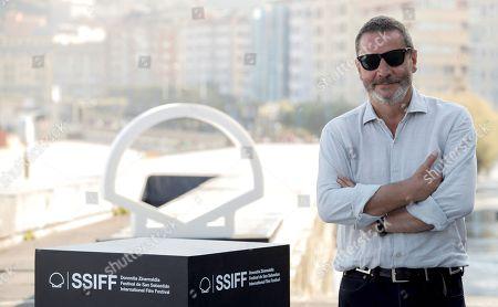 Stock Image of Spanish filmmaker Enrique Urbizu poses during the presentation of the film 'Gigantes', at the 66 edition of San Sebastian International Film Festival, in San Sebastian, Basque Country, northern Spain, 28 September 2018.