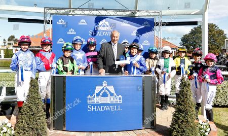 Presentation by Bob Champion to Zac Kent and the other riders afetr The Shetland Pony Grand National Flat Race won by BRIAR SMOKEY JOE Newmarket
