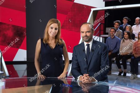 French journalist Lea Salame (L) poses with French Prime Minister Edouard Philippe