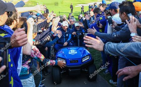 Team Europe Captain Thomas Bjorn and Europe Vice Captain Robert Karlsson are mobbed by fans after the afternoon matches