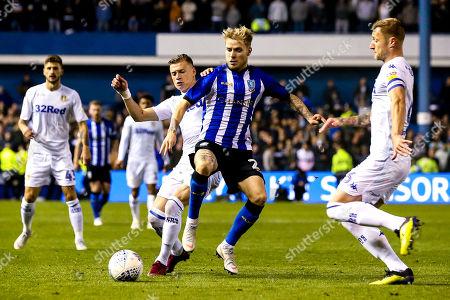 Ashley Baker of Sheffield Wednesday takes on Ezgjan Alioski of Leeds United