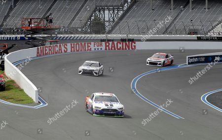 Clint Bowyer, Daniel Suarez, Kurt Busch. Clint Bowyer (14), Daniel Suarez (19) and Ryan Newman (31) drive their cars on the road course during a NASCAR Cup Series auto race practice at Charlotte Motor Speedway in Concord, N.C