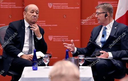 Stock Image of French Foreign Affairs Minister Jean-Yves Le Drian, left, and Ashton Carter, former U.S. Secretary of Defense, speak at the Kennedy School of Government at Harvard University in Cambridge, Mass., on . Le Drian said France's leaders are proposing a new international coalition to revive global cooperation that they say is being threatened by countries like the United States and Russia