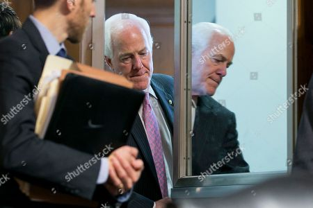 Republican Senator from Texas John Cornyn (R) enters before the Senate Judiciary Committee voted to advance to the Senate floor the nomination of Brett Kavanaugh to be an associate justice of the Supreme Court of the United States, on Capitol Hill in Washington, DC, USA, 28 September 2018. The committee voted to advance Kavanaugh's Supreme Court nomination to the Senate floor, the day after he and Dr. Christine Blasey Ford both testified on allegations of sexual misconduct by Brett Kavanaugh.