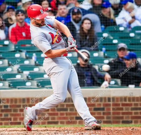 St. Louis Cardinals shortstop Paul DeJong hits an RBI grounder to drive in St. Louis Cardinals first baseman Matt Carpenter against the Chicago Cubs in the sixth inning of their MLB game at Wrigley Field in Chicago, Illinois, USA, 28 September 2018.