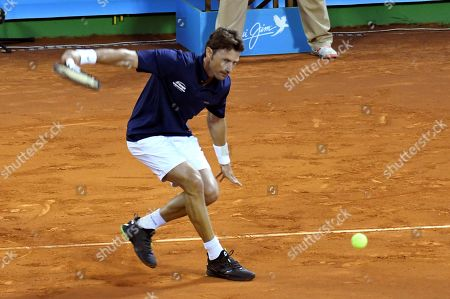 Spanish tennis legend Juan Carlos Ferrero in action against Spanish tennis legend Carlos Moya, during their match of the Masters Seniors Tennis Tournament in which several tennis legends participated at Manolo Santana de Puente Romano facilities in Malaga, Andalusia, Spain, 28 September 2018.