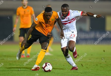 Baker (L) of Kuwait's Qasia SC vie for ball with Mostafa Muhammad (R) of Egypt's Zamalek SC, during the Arab Club Champions Cup Soccer Match, First round Leg 2 of 2, at the Ali Al-Salem Al-Sabah Stadium in Kuwait, Kuwait City, 28 September 2018.
