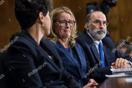 SEPTEMBER 27: Christine Blasey Ford, center, flanked by attorneys Debra Katz and Michael Bromwich, testifies during the Senate Judiciary Committee hearing on the nomination of Brett M. Kavanaugh to be an associate justice of the Supreme Court of the United States, focusing on allegations of sexual assault by Kavanaugh against Christine Blasey Ford in the early 1980s