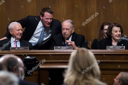 SEPTEMBER 27: Chairman Charles Grassley, R-Iowa, has a word with aide Mike Davis, during testimony by Dr. Christine Blasey Ford during the Senate Judiciary Committee hearing on the nomination of Brett M. Kavanaugh to be an associate justice of the Supreme Court of the United States, focusing on allegations of sexual assault by Kavanaugh against Christine Blasey Ford in the early 1980s. Ranking member Sen. Dianne Feinstein, D-Calif., and Sen. Orrin Hatch, R-Utah, also appear