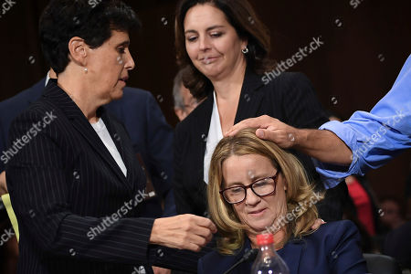 Christine Blasey Ford, the woman accusing Supreme Court nominee Brett Kavanaugh of sexually assaulting her at a party 36 years ago, is comforted by her attorney Debra S Katz at the end of her testimony before the US Senate Judiciary Committee on Capitol Hill in Washington, DC