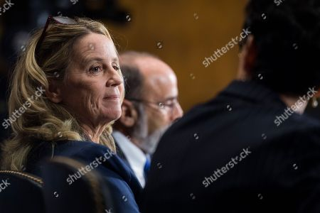 Stock Image of SEPTEMBER 27: Christine Blasey Ford, center, flanked by attorneys Debra Katz and Michael Bromwich, testifies during the Senate Judiciary Committee hearing on the nomination of Brett M. Kavanaugh to be an associate justice of the Supreme Court of the United States, focusing on allegations of sexual assault by Kavanaugh against Christine Blasey Ford in the early 1980s