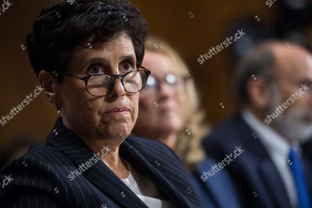 Stock Photo of SEPTEMBER 27: Christine Blasey Ford, center, flanked by attorneys Debra Katz and Michael Bromwich, testifies during the Senate Judiciary Committee hearing on the nomination of Brett M. Kavanaugh to be an associate justice of the Supreme Court of the United States, focusing on allegations of sexual assault by Kavanaugh against Christine Blasey Ford in the early 1980s