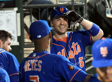 New York Mets' David Wright (5) smiles as he talks with Jose Reyes during the fifth inning of a baseball game against the Miami Marlins on in New York