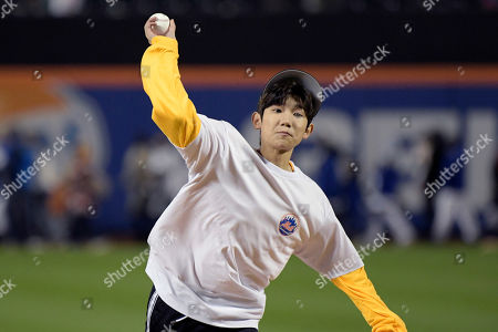 Chinese musician and actor Roy Wang throws out the first pitch before a baseball game between the New York Mets and the Miami Marlins, in New York