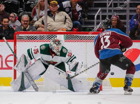 Colorado Avalanche center Alexander Kerfoot is unsuccessful on a penalty shot against Minnesota Wild goaltender Andrew Hammond (35) during the second period of a preseason NHL hockey game, in Denver