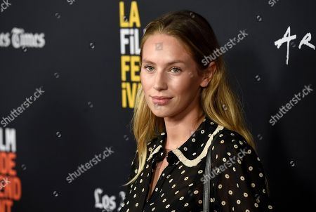 """Dylan Penn arrives at the world premiere of """"Nomis"""" during the closing night of the Los Angeles Film Festival, at the ArcLight Cinerama Dome"""