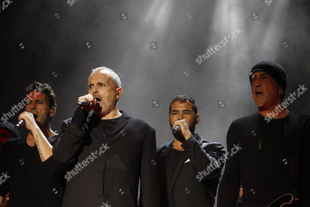 Spanish singer Miguel Bose (2-L) performs during a concert in Medellin, Colombia, 28 September 2018.