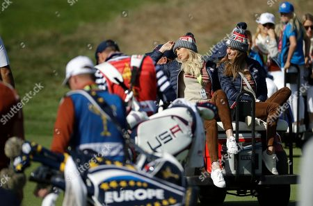 Stock Image of Paulina Gretzky, the partner of Dustin Johnson of the US and Jena Sims, right, the partner of Brooks Koepka of the US drive in a buggy as they follow a foursome match on the second day of the 42nd Ryder Cup at Le Golf National in Saint-Quentin-en-Yvelines, outside Paris, France