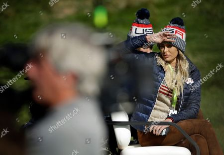 Paulina Gretzky, the partner of Dustin Johnson of the US is driven in a buggy from the 5th green during a foursome match on the second day of the 42nd Ryder Cup at Le Golf National in Saint-Quentin-en-Yvelines, outside Paris, France
